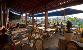 Located in the center of hectic Kisimenti Shopping Center is a little oasis called The Bistro. With a vine-wrapped garden patio outside and leather couches […]